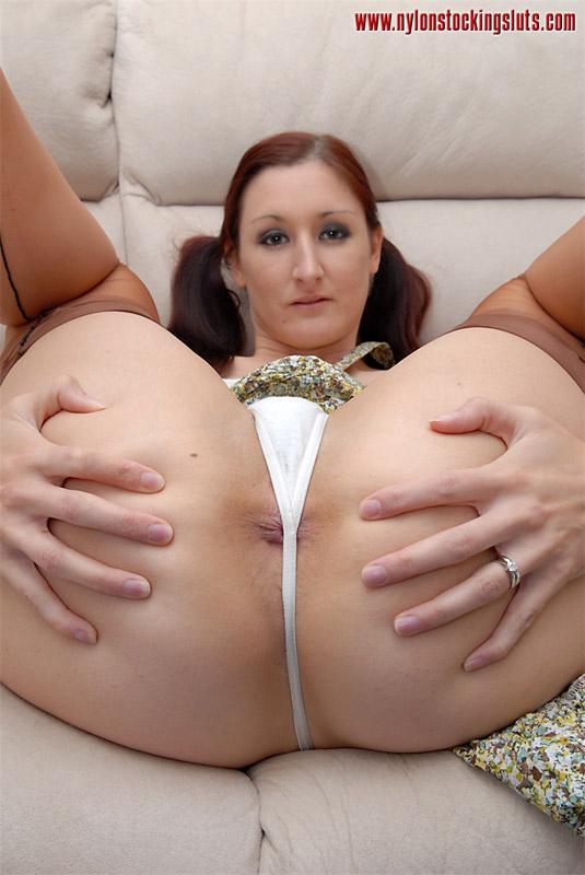 Brunette in thongs