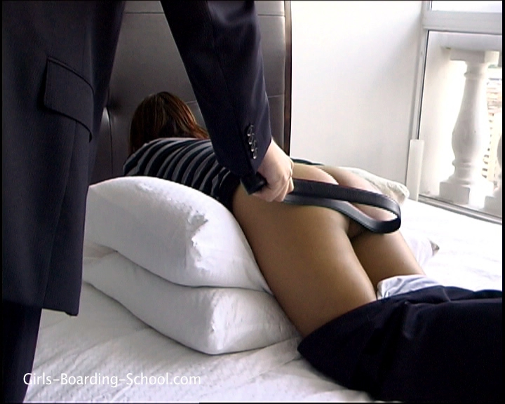 Her bottom jumped as the strap spanked her