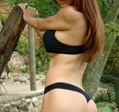 Xiomara strips in the jungle