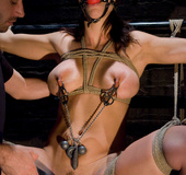 Busty girl sucks cock and ass fucked in bondage.