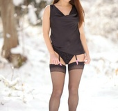 Sexy Carla slips out of her silk top in the snow.