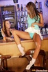 Two lesbian teenie girls toying their pussy inside a bar