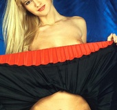 Horny blonde lifting her short red skirt to rub…