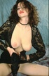 Busty brunette in black lace stripping to reveal…