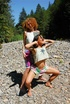 Two natural naked alternative hippis girls playing…