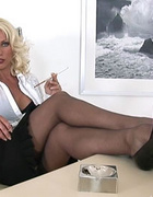 Femme fatale mature office boss