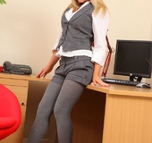 Gorgeous secretary teases her way out of the sexy…
