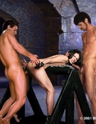Two men put hot iron on slave's exhausted body!