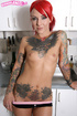 Sexy tattooed redhead plays in the kitchen