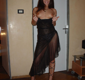 Amazing dark haired milf in black dress seducing…