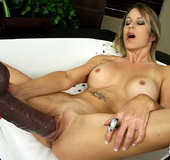 Rebecca Time gets on her knees while pumping dildo…