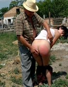 Outdoor caning for a pretty young brunette on her…