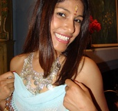 Pretty Indian model Mehla slurping a stiff cock…