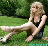 Sexy feet blonde stunner in miniskirt looking so…