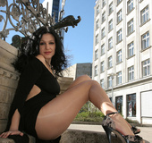 Erotic beauty in sexy nylons and no panties posing…