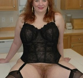 Busty redhead in some sexy black lingerie