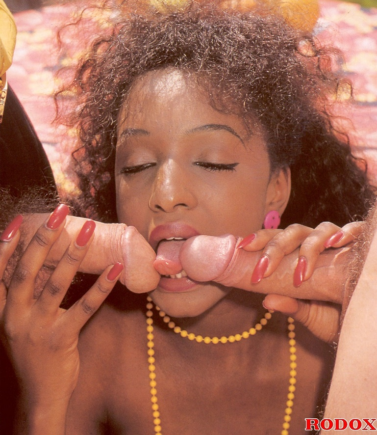 Vintage porn classic - A retro ebony chick sucking two big stiff cocks ...