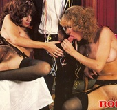Two seventies ladies with stockings sharing a…