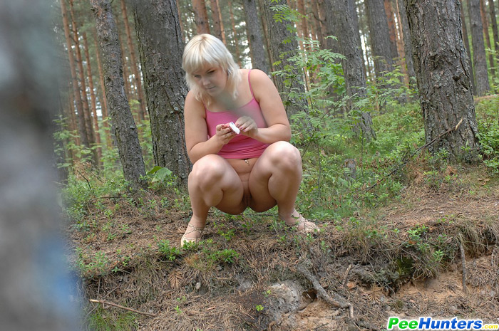 Naked girls peeing in forest