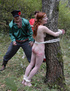 Tearful redhead tied to a tree in the forest and brutally caned - severe