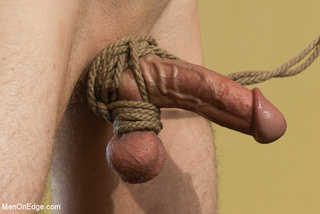 young blindfolded dude tied