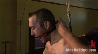 muscular young hunk tied